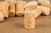 Wine corks on wooden background — Stock Photo