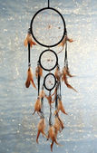 Beautiful dream catcher on blue background with lights — Stock fotografie