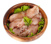 Chicken meat in wooden bowl isolated on white — Stock Photo