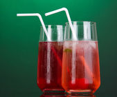 Two cherry cocktails with ice on dark green background — Stock Photo