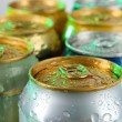 Stock Photo: Metal tins on light green tone