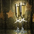 Two glasses of champagne on bright background with lights — 图库照片
