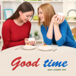 Two girl friends talk and drink tea in kitchen — Stock Photo #25668503