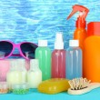 Hotel cosmetics kit on bright color background — ストック写真