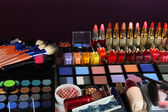 Lot of different cosmetics on purple background — Stock Photo