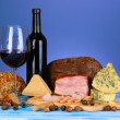 Exquisite still life of wine, cheese and meat products - Stock Photo