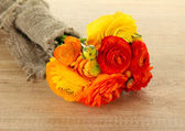 Ranunculus (persian buttercups) on wooden background — ストック写真