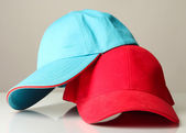 Red and blue caps cap isolated on white — Stock Photo
