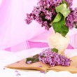 Composition with lilacs on light fabric background — Stock Photo #25706823