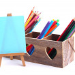 Different pencils in wooden crate and easel, isolated on white — Foto de Stock