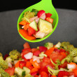 Vegetable ragout in wok, isolated on black - Stock Photo