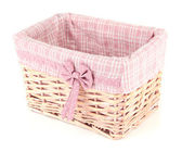 Wicket basket with pink fabric and bow, isolated on white — Stock Photo