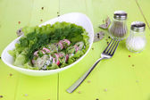 Vitamin vegetable salad in bowl on wooden table close-up — Stock Photo
