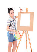 Beautiful young woman painter at work, isolated on white — Stock Photo