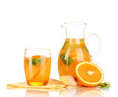 Orange lemonade in pitcher and glass isolated on white — Stock Photo