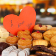 Sweet cookies with valentine card on table in cafe — Stock Photo #25765797