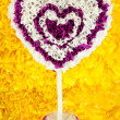 Decorative heart from paper on yellow background — Foto Stock #25766291