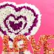 Foto Stock: Decorative heart from paper on pink background