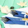 Marine table setting on color wooden background — Stock Photo #25766673