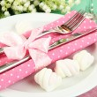 Table setting in white and pink tones on color wooden background — Stock Photo #25766725