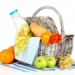 Picnic basket with fruits and bottle of milk, isolated on white — Стоковая фотография
