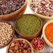 Different kinds of beans in bowls close-up - Stock Photo