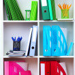 White office shelves with different stationery, close up — Stock Photo #25768263