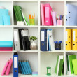 White office shelves with different stationery, close up — Stock Photo #25768279