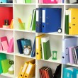 White office shelves with different stationery, close up — Stock Photo #25768293