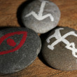 Stock Photo: Fortune telling with symbols on stones on wooden background