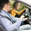 Stock Photo: Learner driver student driving car with instructor