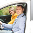 Stock Photo: Portrait of young beautiful couple sitting in the car