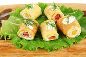 Egg rolls with cheese cream and paprika, on wooden board, close up — Fotografia Stock