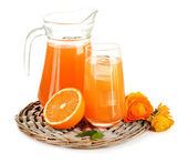 Glass and pitcher of orange juice isolated on white — Stock Photo