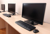 Computers on tables in room — Stock Photo