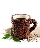 Cup of coffee beans and green beans isolated on white — Stock Photo
