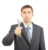 Young businessman with wrench isolated on whit — Stock Photo