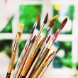 Many brush in paint on window background — Stock Photo