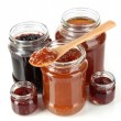Tasty jam in banks isolated on white — Stock Photo