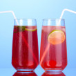 Two cherry cocktails with ice on dark blue background — Stock Photo #25770633