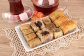 Sweet baklava on plate on table close-up — Foto Stock