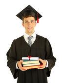 Uomo giovane laurea possesso diploma e libri, isolati su bianco — Foto Stock