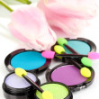 Bright eye shadows and sponge brushes for foundation close up — Stock Photo