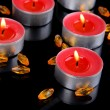 Candles isolated on black — Stockfoto