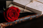 Rose and letters on wooden table close up — Stock fotografie
