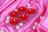 Candles on purple fabric close-up — Stockfoto