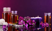 Spa oil and freesia on purple background — Stok fotoğraf