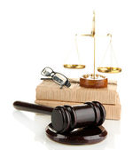 Golden scales of justice, gavel and books isolated on white — Stock Photo