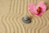 Zen garden with raked sand and round stones close up — Stock Photo