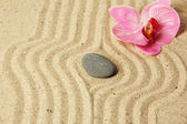 Zen garden with raked sand and round stone close up — Stock Photo